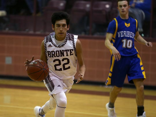 Bronte's Shawn Puentez rushes down court during the fourth quarter of Friday night's game against Veribest in Bronte, Jan. 16, 2017.