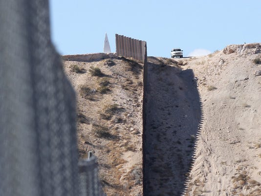 A Border Patrol agent watches over the border in Sunland Park, New Mexico.