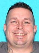 Todd Raymond Keith was purportedly arrested in Ohio Friday night. He's accused of robbing several hotels in the Livonia area and shooting at police, among others.