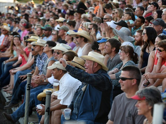 Fans watch bull riding at the St. Paul Rodeo on Tuesday, June 30, 2015.