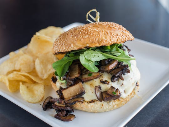 The Truffle Mushroom burger with beef patty, havarti, truffle mushrooms and arugula is part of the Burger Daze promotion at Liberty Market in Gilbert.