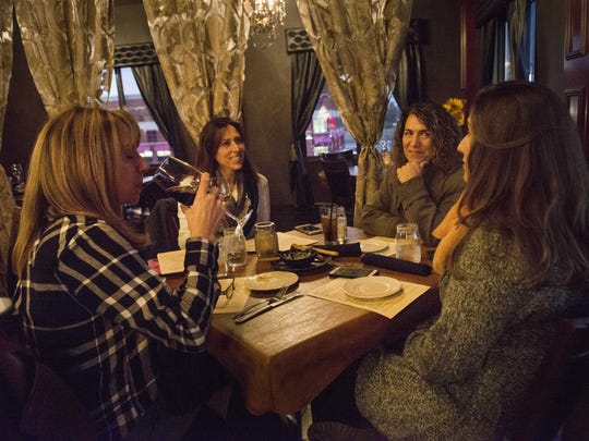 Bonnie Mix, from left, Donna Nowaczyk, Fran Juricmy and Katherine Juricmy enjoy wine in one of two areas at La Cucina del Vino restaurant in Shelby Township.