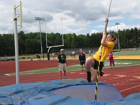 Watkins Memorial sophomore Abigail LaGreca practices vaulting Tuesday as Circleville coach Dick Walters watches and gives feedback. Coaches and athletes from across the area traveled to Watkins Memorial High School to participate in their annual pole vault camp.