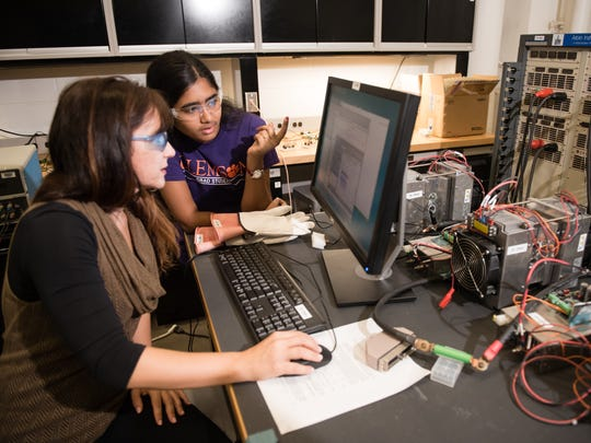 Clemson University Automotive Engineering Assistant Professor Simona Onori, foreground, works in her battery systems lab at CU-ICAR in Greenville with graduate student Akalya Anandan, a Tata Fellow who previously attended PSG College of Technology in India.