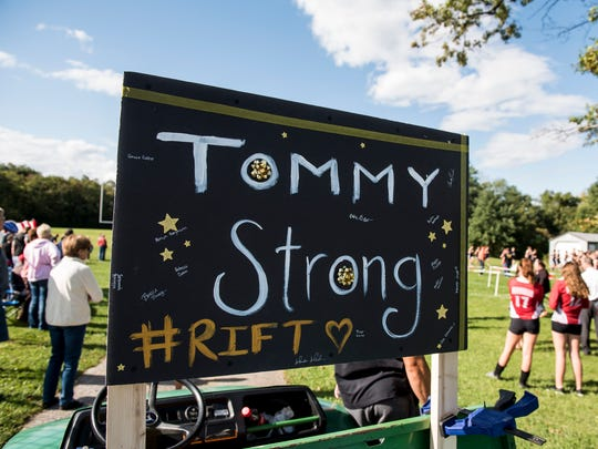 "A sign showing support for Delone Catholic's Tommy Laudani is displayed during a cross country meet at Bermudan Springs on Thursday, September, 7, 2017. #RIFT stands for ""Run It For Tommy."""