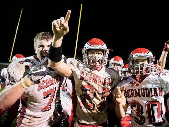 Bermudian Springs players celebrate after coming back to beat Delone in overtime on Friday, Oct. 13, 2017. The Eagles won 10-7.