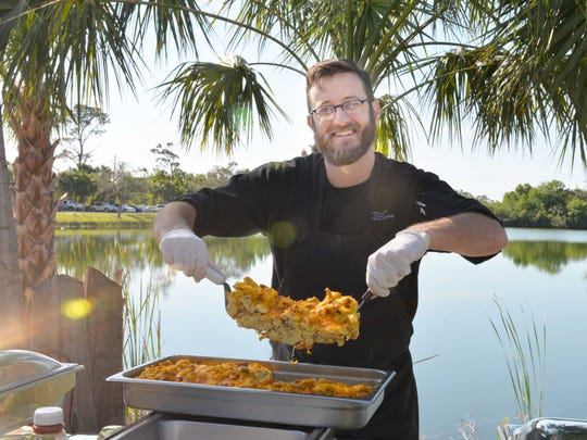 Travis Beckett,  owner of Wild Thyme Catering, prepares