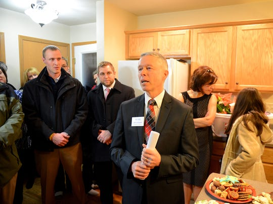 Jeff Johnson, executive director for Greater Green Bay Habitat for Humanity, says farewell inside a new home during the dedication ceremony December 19, 2014.
