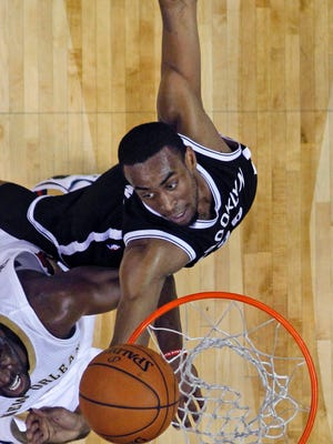 Alexandria native Markel Brown (22) of the Brooklyn Nets battles under the basket with New Orleans Pelicans guard Quincy Pondexter in Wednesday's NBA game in New Orleans.