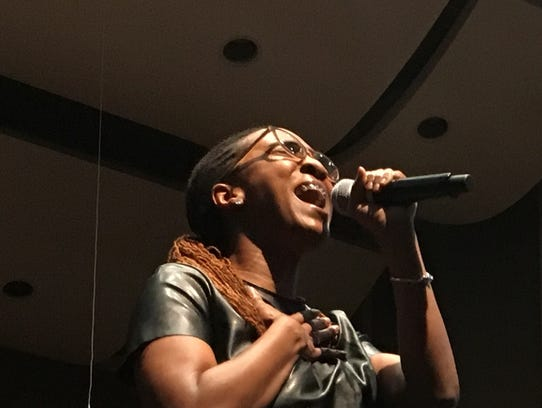 """Carla Anderson performs the song """"Total Praise"""" as"""