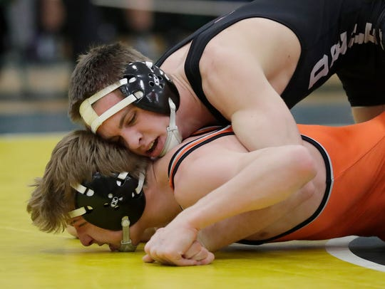 De Pere's Max Bruss wrestles Kaukauna's Harrison Brooks in a 145-pound match Saturday at the WIAA Division 1 wrestling sectional meet at Preble.
