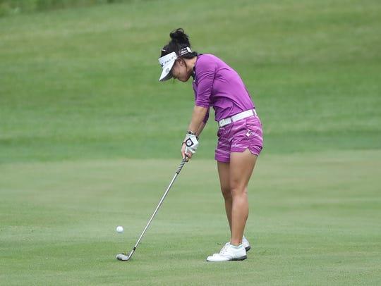 Jennifer Hahn hits a shot to the ninth green during