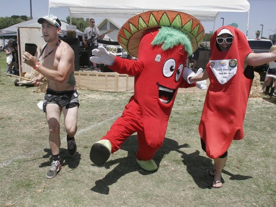 Bobby Lagin dances with the chilis during a Thousand Oaks Rotary Club Chili Cook-off. The event is now in its 41st year.