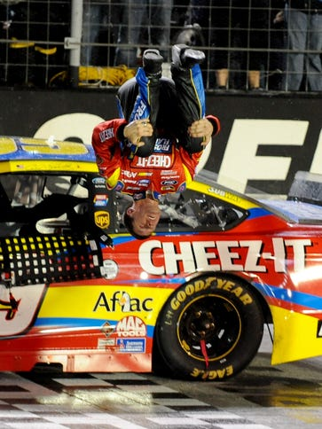 Carl Edwards performs his traditional backflip after