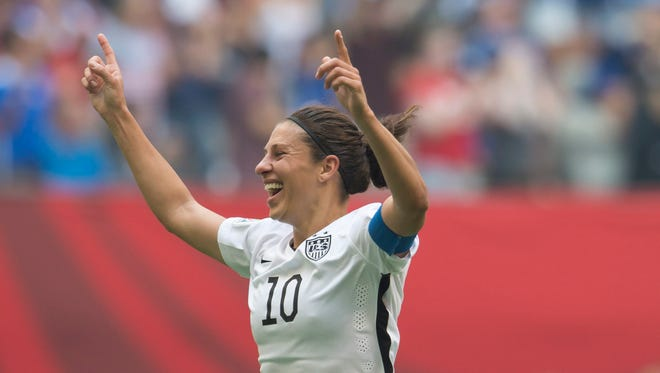 United States' Carli Lloyd celebrates her goal against Japan during the first half of the FIFA Women's World Cup soccer championship in Vancouver, British Columbia, Canada, Sunday, July 5, 2015. (Jonathan Hayward/The Canadian Press via AP) MANDATORY CREDIT