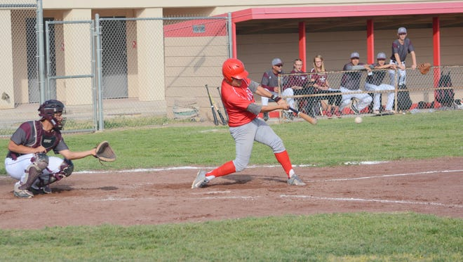 Loving's Josh Leija hits an RBI single up the middle in Tuesday's district game against Tularosa.