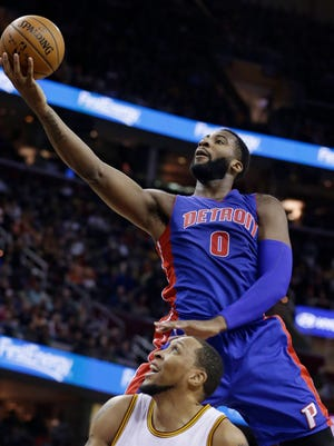 Detroit Pistons' Andre Drummond (0) jumps over Cleveland Cavaliers' Shawn Marion (31) during the first half of an NBA basketball game Sunday, Dec. 28, 2014, in Cleveland.