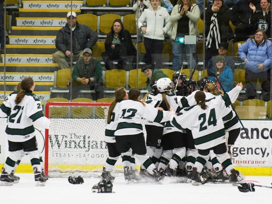 Stowe celebrates the championship during the Vermont