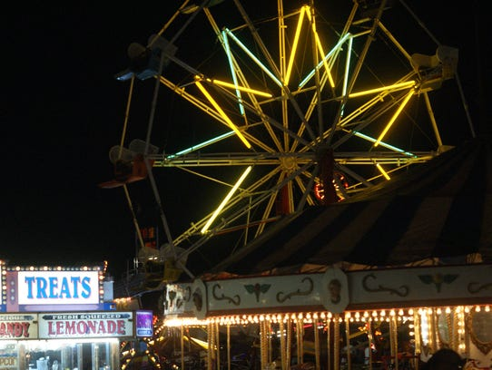 The carnival was busiest at night, lighting up the
