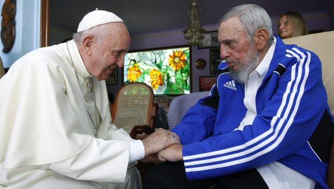 Pope Francis and former Cuban president Fidel Castro meet at Castro's residence in Havana on Sunday.