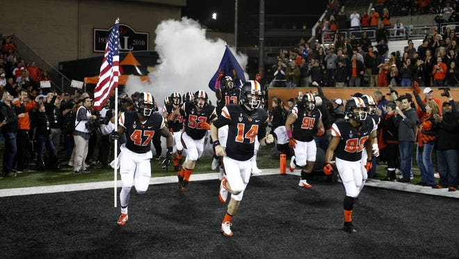 Oregon State players come onto the field before an NCAA college football game, in Corvallis, Ore., on Saturday, Oct. 24, 2015.