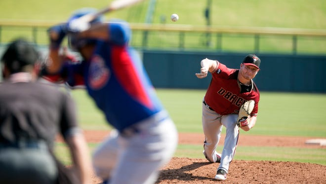 Diamondbacks pitcher Shelby Miller pitches against the Cubs team during an extended spring-training game at Sloan Park in Mesa on Saturday, June 4, 2016.