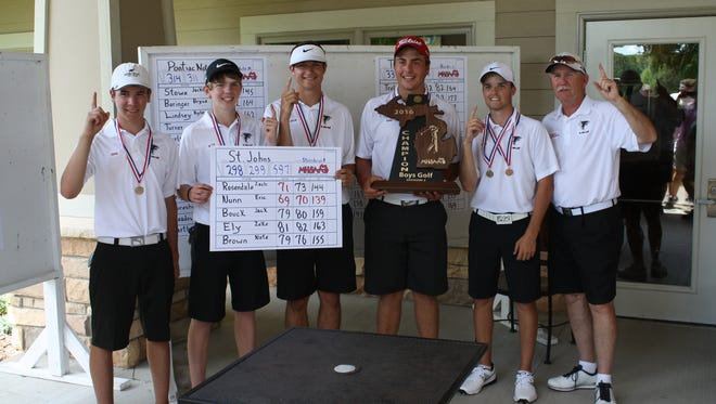 St. Johns golfers celebrate their first state title in 55 years. From left are Zeke Ely, Nate Brown, Jack Bouck, Eric Nunn, Zach Rosendale and coach Paul Sternburgh.