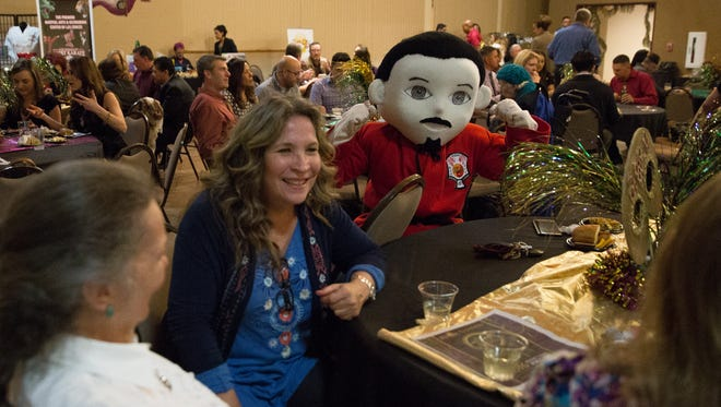 Beverly Chavez, center, owner of Patina Home, a winner in the 2016 Las Cruces Sun-News Readers Choice awards speaks with her team Elizabeth Bennett, left, and Traci Pelayo, right. Sensei, the mascot from winner Guzman Sport Karate and Kickboxing, flexes before the awards ceremony Wednesday at the Farm and Ranch Heritage Museum.