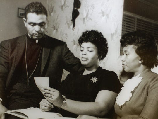 This photo of Linda Brown, center, pictured with her