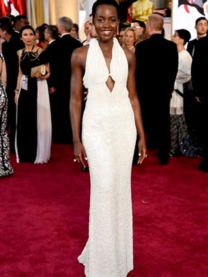Lupita Nyong'o arrives at the Oscars wearing a dress made of pearls at the Dolby Theatre in Los Angeles.  Los Angeles sheriff's detectives are investigating the theft of the $150,000 custom Calvin Klein dress worn by Nyong'o at the 2015 Academy Awards. The dress was reported stolen from Nyong'o's West Hollywood hotel room late Wednesday.