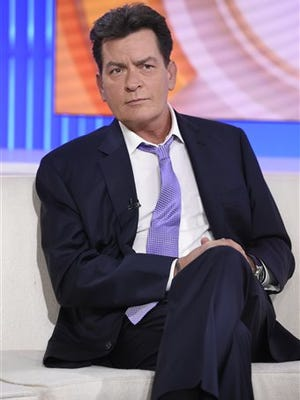 """Former """"Two and a Half Men"""" star Charlie Sheen, right, is interviewed Tuesday, Nov. 17, 2015 on NBC's """"Today"""" in New York. In the interview, the 50-year-old Sheen said he tested positive four years ago for the virus that causes AIDS. (Peter Kramer/NBC via AP)"""