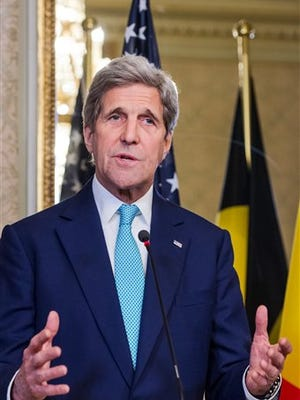U.S. Secretary of State John Kerry addresses the media after a meeting with Belgium's Prime Minister Charles Michel at the Prime Minister's residence in Brussels, Belgium, Friday, March 25, 2016. Kerry is holding counterterrorism talks in Brussels on Friday as top members of Belgium's embattled government face ongoing criticism for a series of security and intelligence failings in the run-up to this week's bomb attacks in the city that killed over 30 people and wounded hundreds. (AP Photo/Geert Vanden Wijngaert)