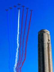 Members of Patrouille de France make a centennial commemoration flight during ceremonies at the nation's official WWI monument, Liberty Memorial, in Kansas City, Mo., Thursday, April 6, 2017.