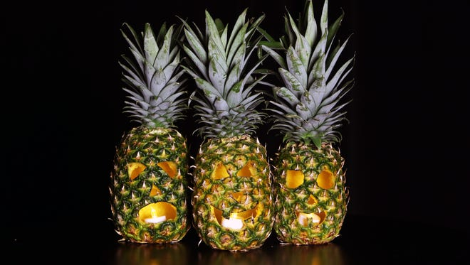 Carve pineapples instead of pumpkins this Halloween for a special, tropical-themed holiday.