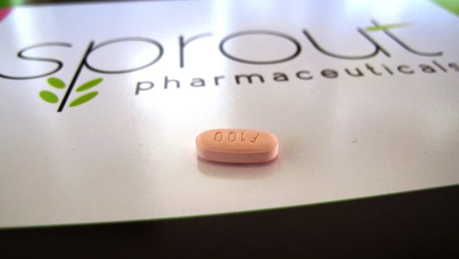 Flibanserin, shown here, is intended to boost the female sex drive, but has side effects like fatigue, low blood pressure and fainting.
