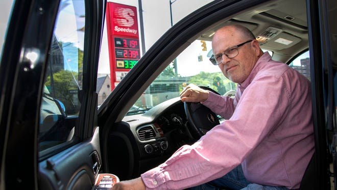 "3-year-Uber driver Mike Kuzniar, 53, of Ferndale, is feeling the pinch at the pump as gas prices begin to sharply rise. Kuzniar, who poses for a portrait Wednesday, May 23, 2018 at the Speedway gas station on Detroit's east side says ""it is eating away at my profits"" as prices are predicted to continue rising through the Memorial Day holiday weekend."