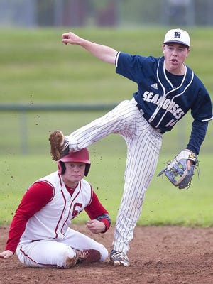 Burlington second baseman Eli Pine, right, watches his throw to first to turn a double play in the third inning against Champlain Valley in the Division I high school baseball quarterfinals on Saturday afternoon.