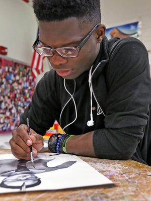 Nigerian immigrant Abiodun Akinseye works on his art project at Northwest High School, Monday, May 7, 2018.  He will be the valedictorian this year.