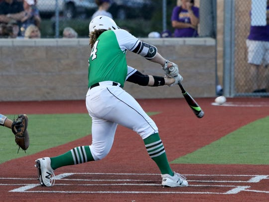 Iowa Park's Derek Hostas hits a single against Godley in Game 3 of the Region I-4A finals Friday, June 1, 2018, at Northwest High School in Justin.