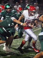 Holliday's Kade Patterson (12) runs up the middle