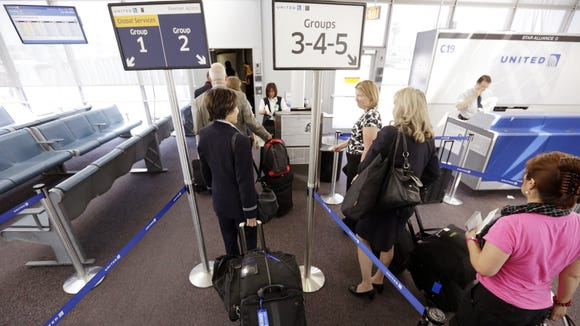 This photo from May 8, 2013, shows United passengers