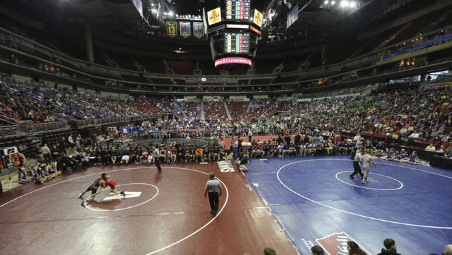 Charlie Litchfield/The Register Wrestlers square off Thursday for the first day of the Iowa state wrestling tournament. Class 3-A is from 9 a.m. to noon, Class 2-A from 1:30-4:30 p.m. and Class 1-A from 6-9 p.m. Wrestlers square off on Wednesday, Feb. 18, 2015, at the Iowa High School State Wrestling duals meet at Wells Fargo Arena in Des Moines, Iowa.