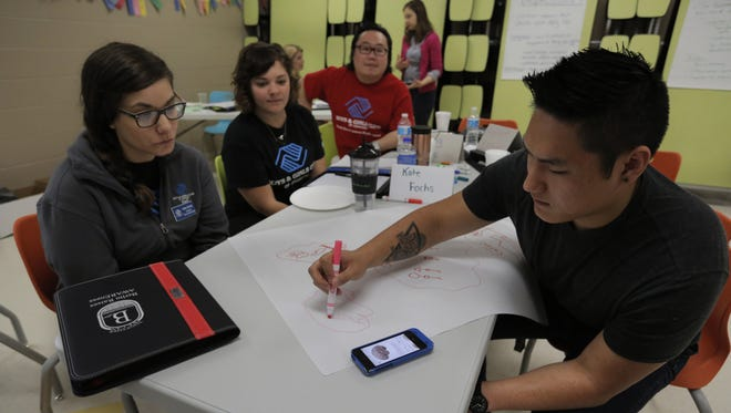 Jake Stumpner instructs on adolescent thought by diagramming a brain as part of a session at the Boys and Girls Club in Berlin. The program is sponsored by a grant given to the Berlin Area School District, which has implemented programs that have reduced delinquency among students in the district.
