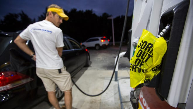Andrew Castle fills up his car with diesel, the only gas left at a Shell in Mt. Pleasant, S.C., on Oct. 4, 2016, in advance of Hurricane Matthew which is expected to affect the South Carolina coast by the weekend. Gov. Nikki Haley announced Tuesday that, unless the track of the storm changes, the state will issue an evacuation order Wednesday to help get 1 million people inland from the coast. 'Couldn't get gas at any other place,' Castle said.
