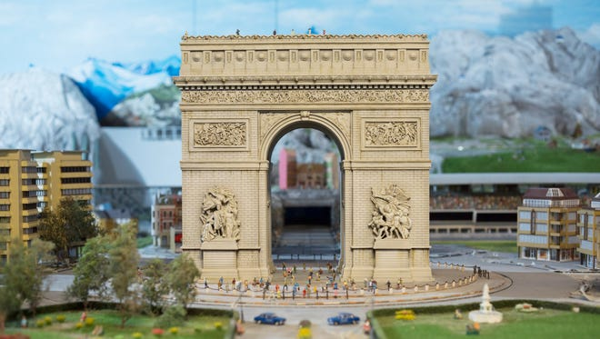 Paris' Arc de Triomphe is depicted in the Europe section.