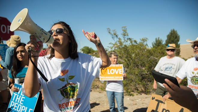 """Johana Bencomo, a community organizer with NM Communidades en Accion y de Fé asks the crowd of protesters """"What do we want?"""" responded """"Justice!"""" The chant continued  """"When do we want it?... Now!"""" Bencomo and NM Cafe lead a protest and civil disobedience action at the Border Patrol station in Las Cruces. Thursday May 4, 2017."""
