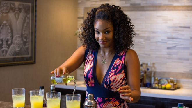 """Dina (Tiffany Haddish) uses a secret ingredient in her mixed drinks in """"Girls Trip."""""""