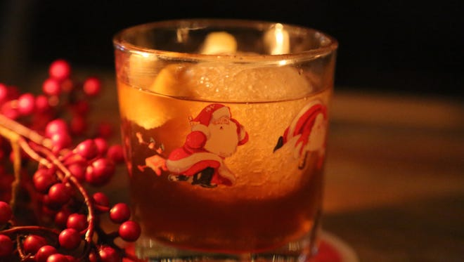 A Snowball Old Fashioned made with gingerbread bourbon and wormwood bitters from Miracle, a Christmas-themed pop-up bar that runs through December 24 at the Skip in Detroit's Belt Alley.