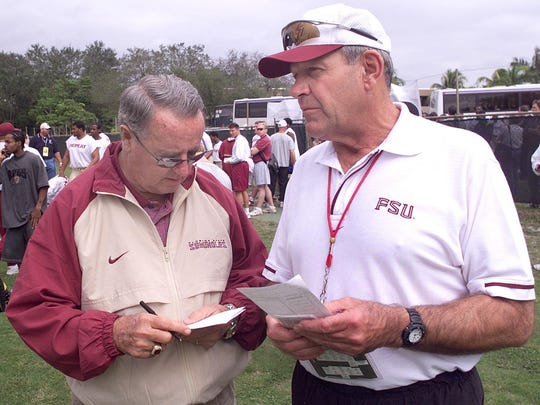 Florida State coach Bobby Bowden, left, and assistant head coach Jim Gladden go over their notes prior to a practice.