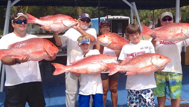 This outstanding team catch of red snapper was taken offshore Ponce Inlet in 2014, the last year that Atlantic Coast anglers were allowed to take one snapper each during three-day mini seasons. Sport anglers would like to see longer red snapper seasons if Congress passes the Modern Fish Act, now pending in both houses.